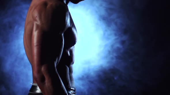 Thumbnail for Bodybuilder Training Biceps with a Barbell. Black Smoke Background. Slow Motion