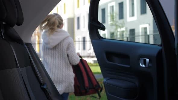 Thumbnail for Schoolgirl Arriving To School in Parent's Car