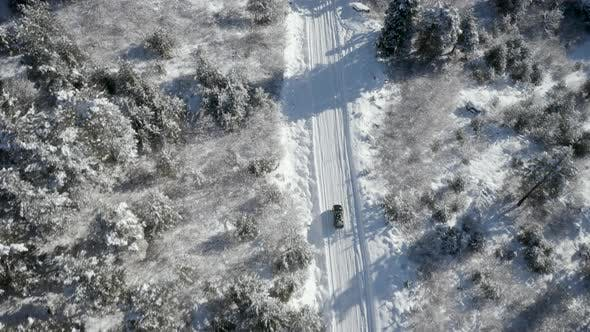 Vehicle Driving Winter Road In Countryside Aerial Top Down