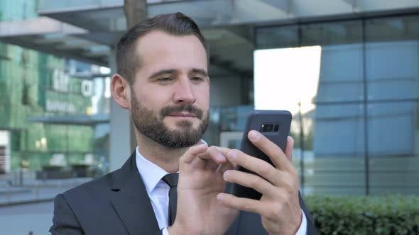 Thumbnail for Beard Businessman Using Smartphone for Browsing online