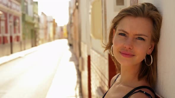 Thumbnail for Gorgeous Blonde Model Leaning Against the Wall in a Lonely Street