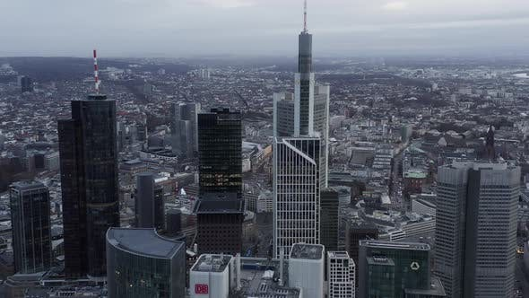 Thumbnail for AERIAL: Pan Shot Into Frankfurt Am Main, Germany Skyline on Cloudy Grey Winter Day