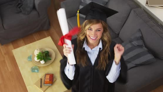 Thumbnail for Female graduate celebrating with diploma