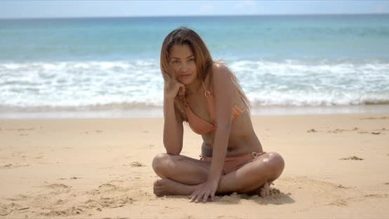 Thumbnail for Happy Ethnic Woman Sitting on Sandy Beach