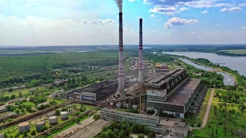Factory air pollution. Plant emits smoke and smog from the pipes