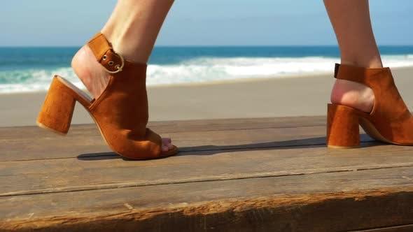 Model's Feet Passing in Frame