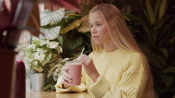 Thumbnail for Blond Teenage Girl With Milkshake In Cafe