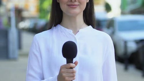 Female Correspondent Holding Microphone Outdoors, Interview Questions, Opinion