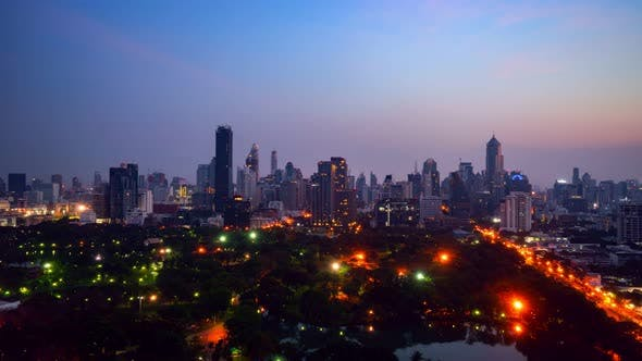 Day and night transition time lapse of cityscape and buildings in metropolis