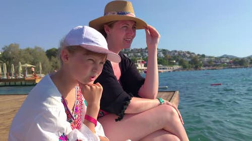 Girl With Mother On The Pier