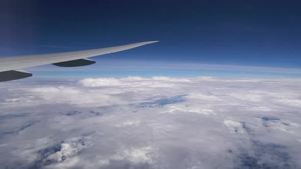 Thumbnail for Airplane Flying High in the Clouds. Plane Wing During Flight