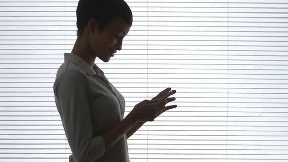 Thumbnail for Black business woman using cell phone