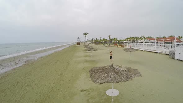 Thumbnail for Pretty Woman Running on The Beach, Healthy Lifestyle, Aerial Shot Along Shore
