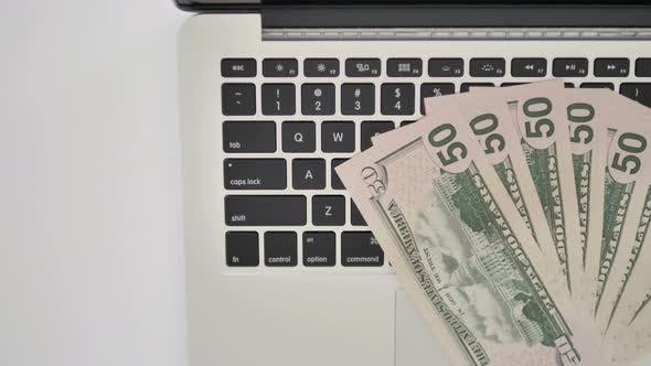Thumbnail for Top View of Dollars on Keyboard of Laptop, Business Concept