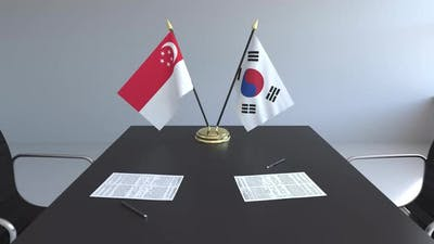 Flags of Singapore and South Korea on the Table
