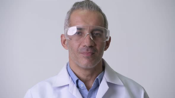Thumbnail for Happy Persian Man Doctor Wearing Protective Glasses