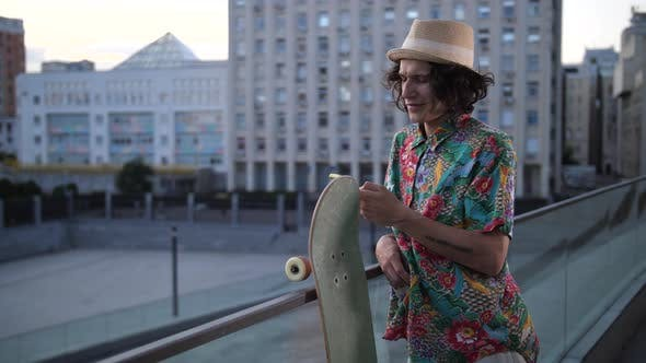 Cover Image for Skater Smiling While Networking on Phone Outdoor