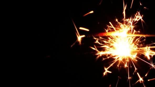 Thumbnail for Sparkler Squib On Black Background