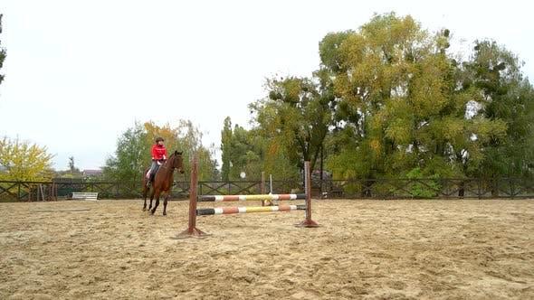 Woman Jockey Training Riding Horse