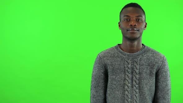 Thumbnail for A Young Black Man Smiles at the Camera - Green Screen Studio
