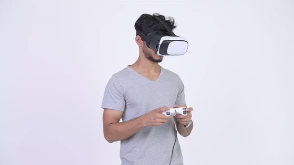 Thumbnail for Young Handsome Bearded Indian Man Using Virtual Reality Headset While Playing Games