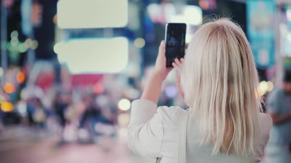 Thumbnail for Tourist Takes Pictures with a Smartphone on the Famous Times Square in New York, Rear View
