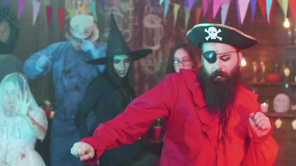 Thumbnail for Handsome Man Dressed As a Pirate Is Dancing at a Halloween Party