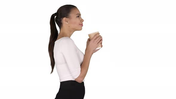 Thumbnail for Relaxed stylish businesswoman drinking coffee walking on
