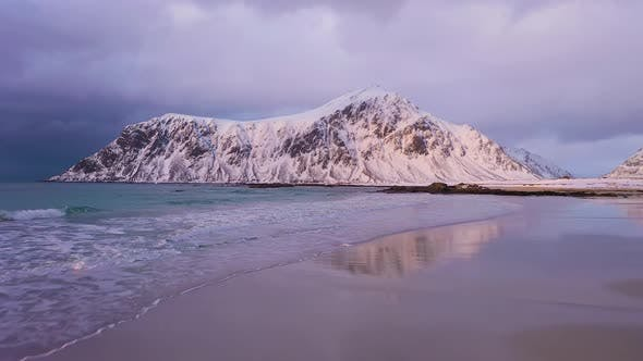 Skagsanden Beach and Mountains in Winter. Lofoten Islands, Norway. Aerial View