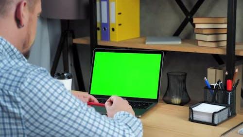 Green screen laptop concept: Businessman tells listen employee online video call