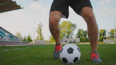 Skill Professional Soccer Player a Man Runs in with a Soccer Ball on a Soccer Field in a Stadium