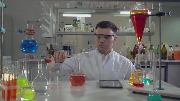 Adult Doctor Working in Microbiological or Chemistry or Medical Laboratory