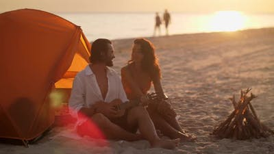 Romantic Couple Near a Tent on the Beach