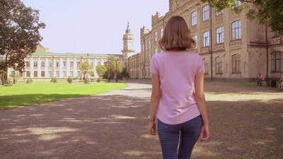 Woman Walking on Campus