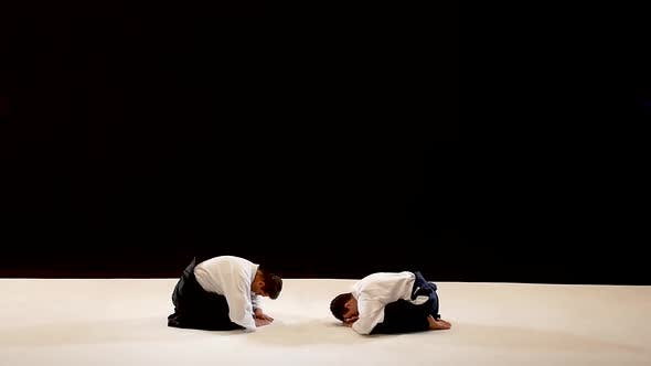 Thumbnail for Two Masters Martial Arts Aikido Bow To Each Other. Shot Isolated on Black and White Background. Slow