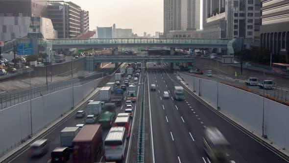 Timelapse Busy Traffic Highway Between Tokyo Buildings