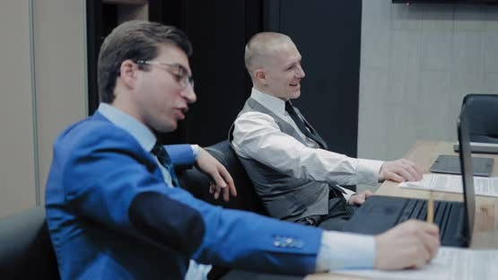 Colleagues Lead a Meeting in the Office