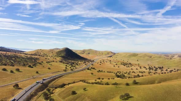Thumbnail for Highway and Hilly Farmland. Kern County. California, USA. Aerial View