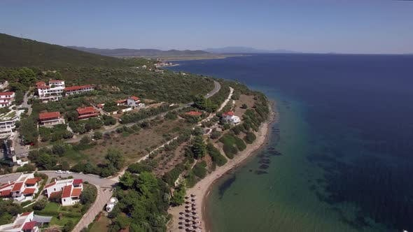 Thumbnail for Flying Over Sea, Cottages and Resort on the Coast. Trikorfo Beach, Greece