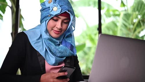 Young arabic woman talking with customer work at home