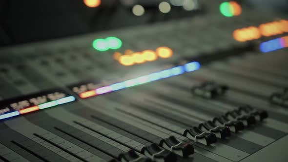 Thumbnail for Lighting Buttons, Adjusting Knobs and Faders on Expensive Audio Mixing Console