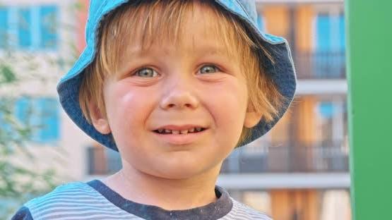 Kid Boy Having Fun to Play on Children Playground
