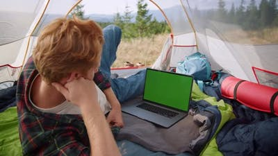 Man Watching Moving on Laptop with Chroma Key