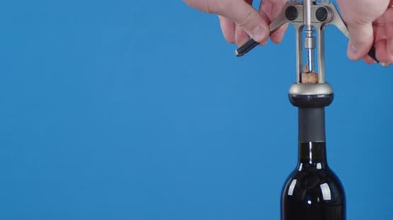 Men's Hands Corkscrew Open a Bottle of Wine