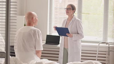 Doctor Telling Cancer Patient Good News