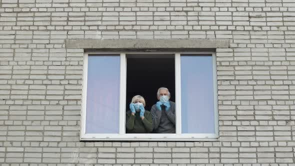 Thumbnail for Old Grandparents Stay at Window Isolated at Home on Quarantine. Coronavirus