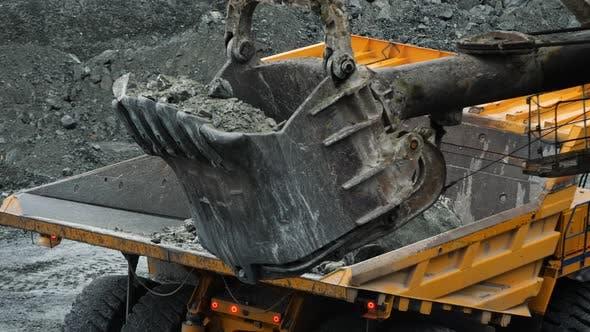 Thumbnail for Excavator Fills Dump Truck