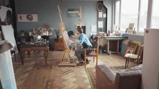 Male Artist Satisfied with Artwork