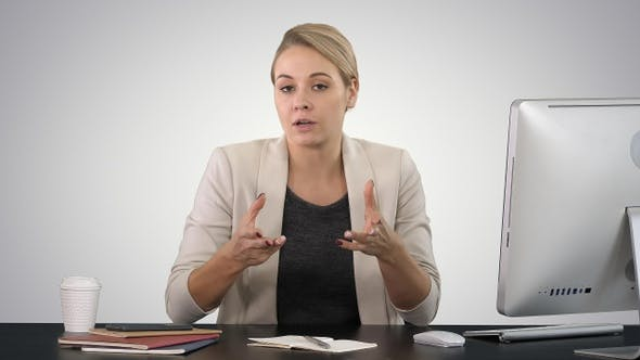 Thumbnail for Beautiful young businesswoman giving a speach to the camera
