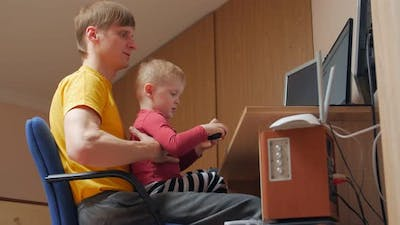Boy With Dad At The Computer
